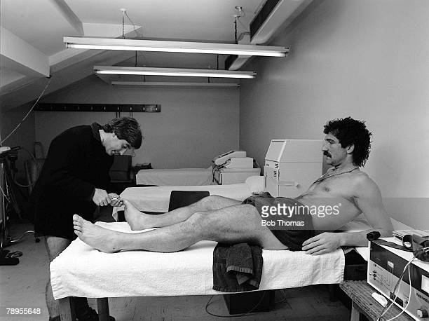 Football Liverpools Roy Evans works on Graeme Souness in the treatment room at Anfield