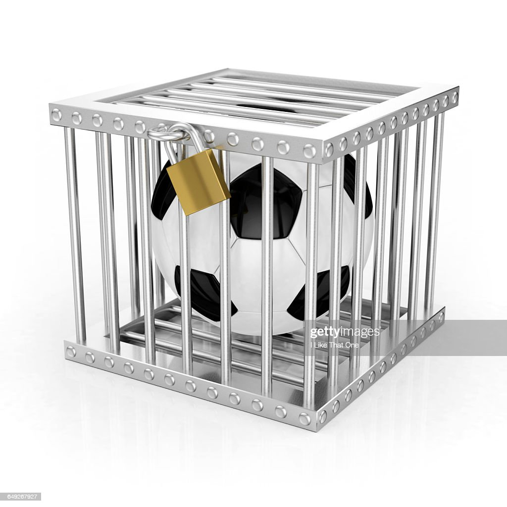 Football locked in jail / cage : Stock Photo