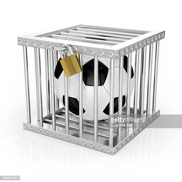 football locked in jail / cage - atomic imagery stock pictures, royalty-free photos & images