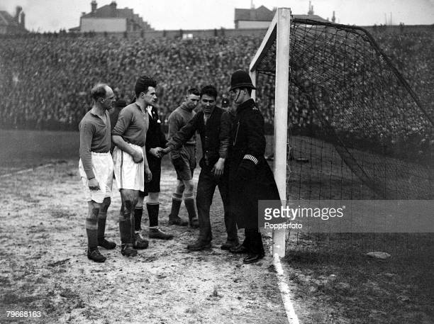 Football London England 25th January 1931 FA Cup A fan in the Everton goalmouth with goalkeeper Coggins and dismayed police and players attempting to...