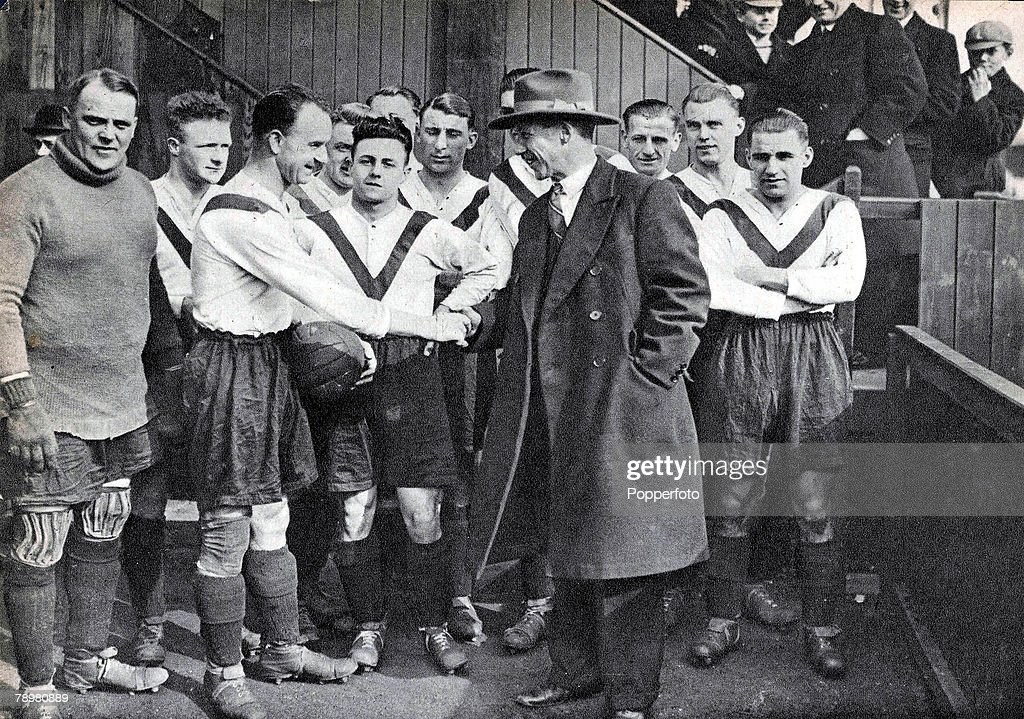 Football. 1931. London. Jimmy Seed is greeted by the players after taking over as Manager of Clapton Orient. Seed had an illustrious career as a player with Tottenham Hotspur, where he was a key member of their FA Cup winning side of 1921, and won 5 Engla : News Photo