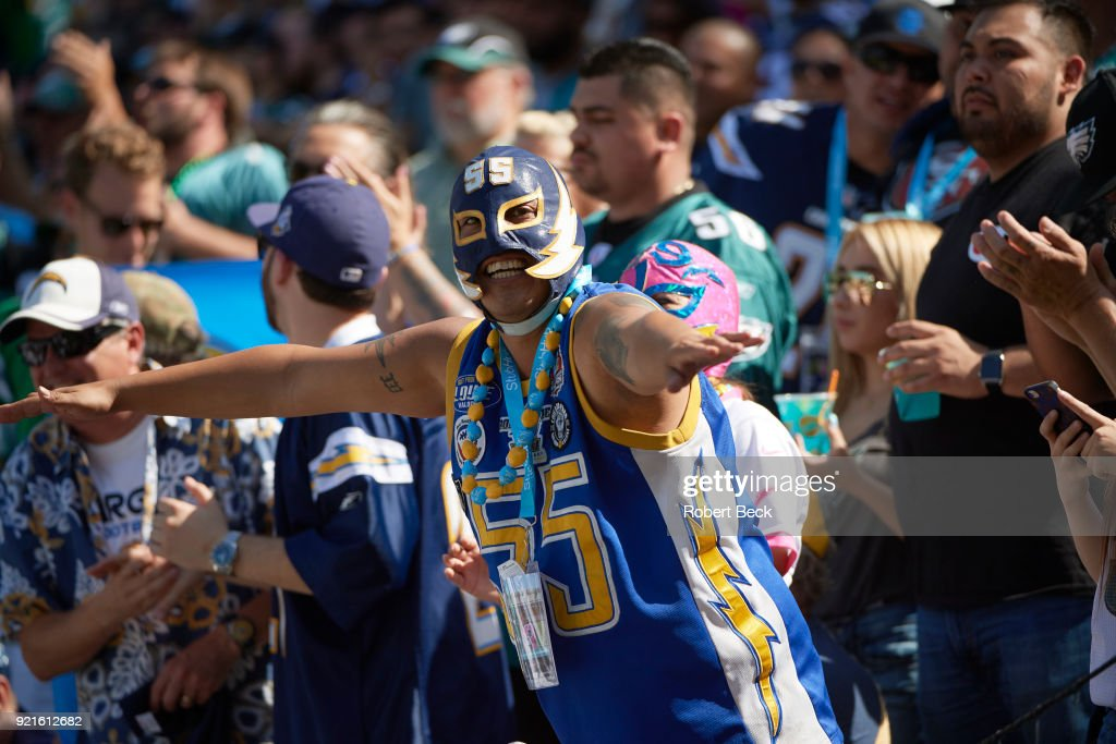 Los Angeles Chargers fan in stands wearing mask during game vs Philadelphia Eagles at StubHub Center. Robert Beck TK1 )