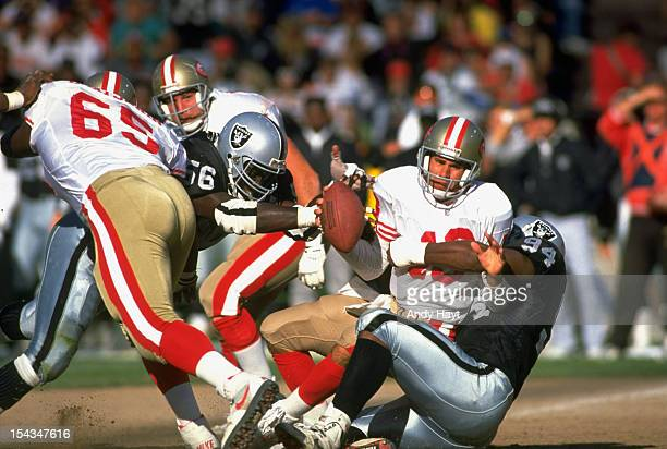 Los Angeles Raiders Aundray Bruce and Anthony Smith in action tackle vs San Francisco 49ers QB Steve Bono during preseason game at Candlestick Park...