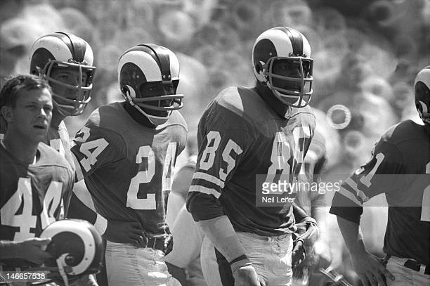 Los Angeles Rams Chuck Lamson , Merlin Olsen , Clancy Williams , and Lamar Lundy on sidelines during game vs New Orleans Saints at Tulane Stadium....