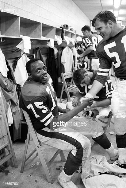 Los Angeles Rams Deacon Jones and George Burman in locker room after game vs New Orleans Saints at Tulane Stadium New Orleans LA 9/17/1967CREDIT Neil...