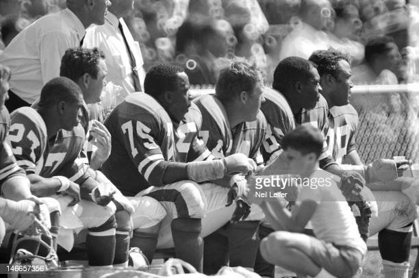 Los Angeles Rams Deacon Jones , Merlin Olsen , and Lamar Lundy on sidelines with teammates during game vs New Orleans Saints at Tulane Stadium. New...