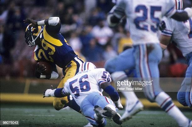 Los Angeles Rams Eric Dickerson in action vs Houston Oilers Robert Abraham Anaheim CA 12/9/1984 CREDIT Peter Read Miller