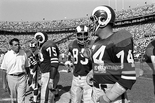 Los Angeles Rams head coach George Allen Deacon Jones Lamar Lundy and Merlin Olsen on sidelines during game vs New Orleans Saints at Tulane Stadium...