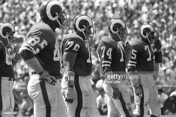 Los Angeles Rams Lamar Lundy , Roger Brown , Merlin Olsen , and Deacon Jones during game vs New Orleans Saints at Tulane Stadium. Fearsome...