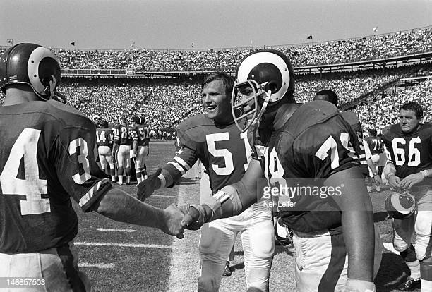 Los Angeles Rams Les Josephson , George Burman , and Roger Brown victorious on sidelines during game vs New Orleans Saints at Tulane Stadium. New...