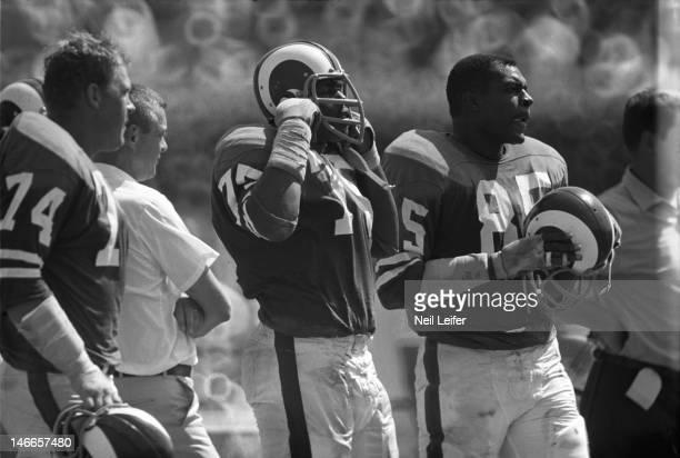 Los Angeles Rams Merlin Olsen , Bob Nichols and Lamar Lundy during game vs New Orleans Saints at Tulane Stadium. New Orleans, LA 9/17/1967CREDIT:...