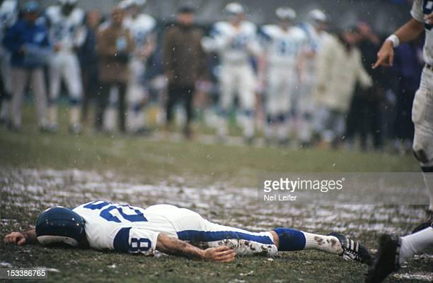 Los Angeles Rams Pat Studstill lying on ground during game vs Minnesota Vikings at Metropolitan Stadium Bloomington MN CREDIT Neil Leifer