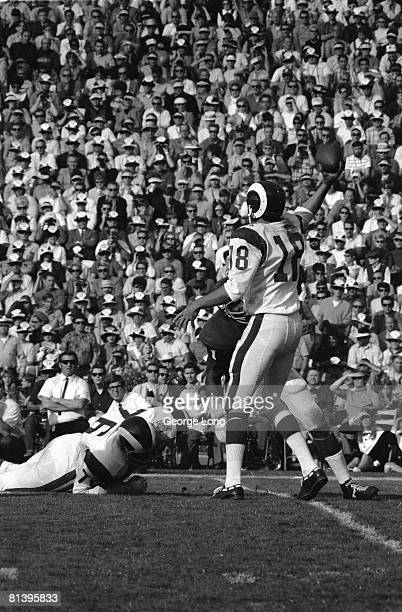 Football Los Angeles Rams QB Roman Gabriel in action making pass vs Minnesota Vikings View of Rams Bob Brown on ground Los Angeles CA 12/7/1969