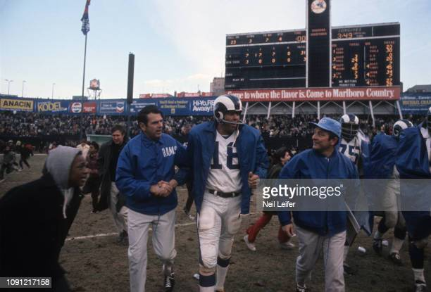 Los Angeles Rams QB Roman Gabriel walking off field and shaking hands with coach George Allen after game vs New York Giants at Yankee Stadium. Bronx,...