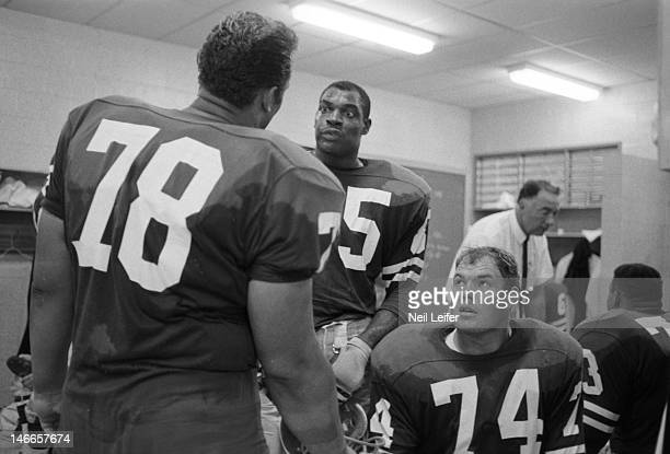Los Angeles Rams Roger Brown , Lamar Lundy , and Merlin Olsen in locker room after game vs New Orleans Saints at Tulane Stadium. New Orleans, LA...