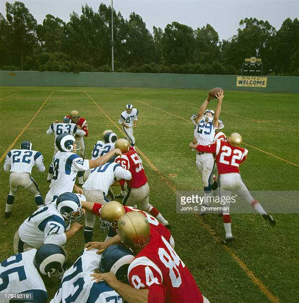 Los Angeles Rams Tommy McDonald in action, making catch from QB Roman Gabriel pass during practice at Blair Field. Cover. Long Beach, CA 9/2/1966...