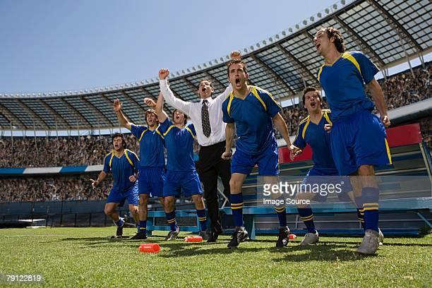 - manager und Fußballer feiert