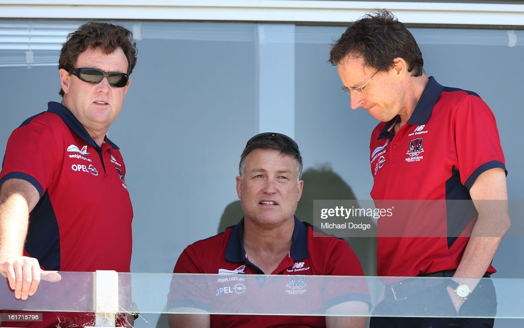 Football manager Chris Connolly, recruiting manager Todd Viney and CEO Cameron Schwab talk together during a Melbourne Demons intra-club match session session at Casey Fields on February 15, 2013 in Melbourne, Australia.