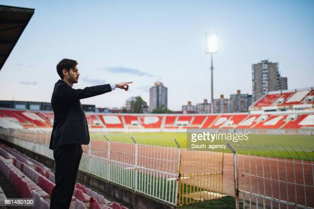 football manager standing on stadium - sports venue stock pictures, royalty-free photos & images