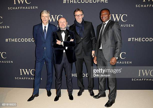 Football managers Arsene Wenger CEO of IWC Georges Kern football manager Laurent Blanc and footballer Marcel Desailly visit the IWC booth during the...