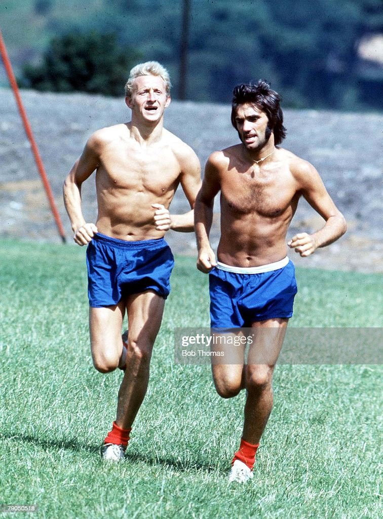 Football. Manchester United footballer George Best (R) training with teammate Denis Law : News Photo