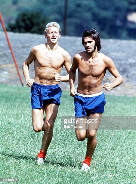 Football Manchester United footballer George Best training with teammate Denis Law