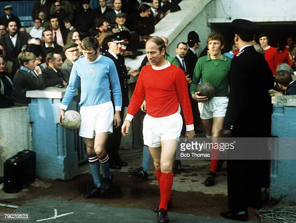 Football Manchester United's Bobby Charlton leads out his team before the match with local rivals Manchester City