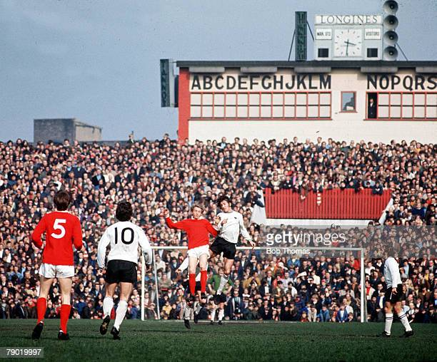 Football Manchester United's Denis Law jumps up for the ball with Derby County's Roy McFarland during their league match at Old Trafford