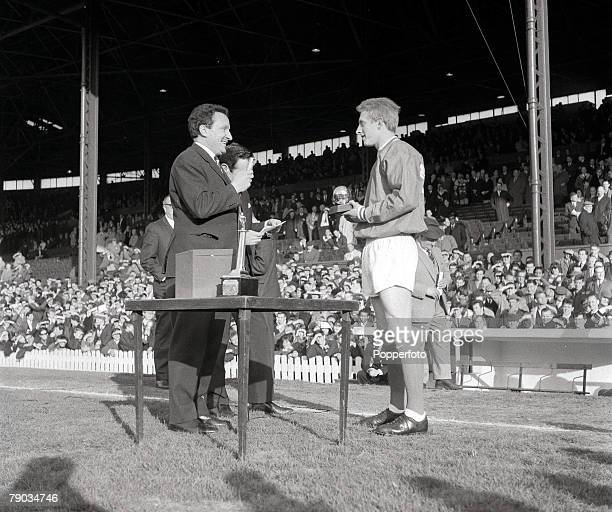 Football Manchester United's Denis Law receives the European Footballer of the Year award for 1964