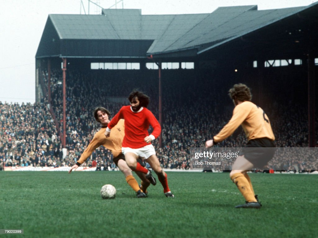 Football. Manchester United's George Best is tackled by Wolverhampton Wanderer's McCalliog from behind during their league match at Old Trafford, 1971. : News Photo