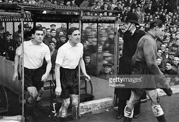 Football March 1958 Arsenal v Tottenham Hotspur Spurs players Ted Ditchburn Danny Blanchflower and Ron Henry emerge from the Highbury tunnel ready...