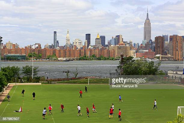 Football march in Williamsburg with NYC skyline
