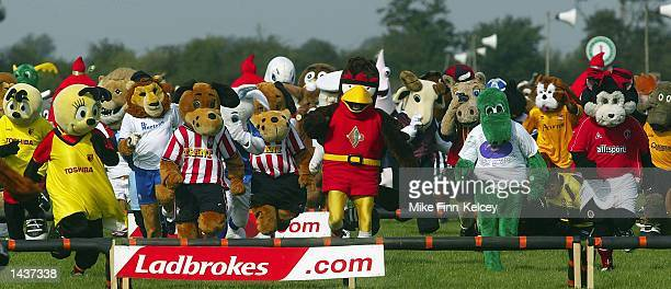 Football mascots from the UK in action during the fourth Mascot Grand National race at Huntingdon Racecourse Huntingdon on September 29 2002