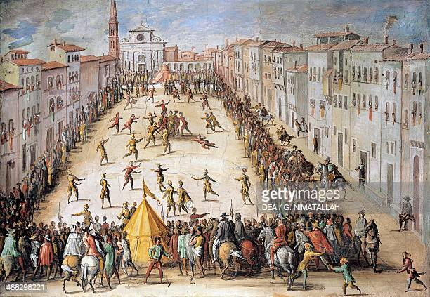 Football match in Piazza Santa Maria Novella in Florence painting by Jan Van der Straet known as Giovanni Stradano based on a design by Giorgio Vasari