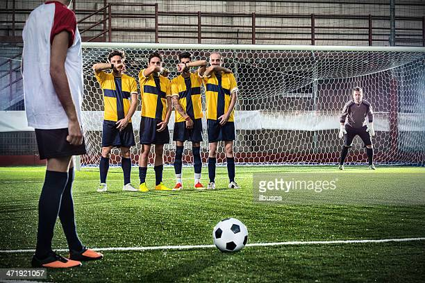 football match in stadium: free kick - defender soccer player stock photos and pictures