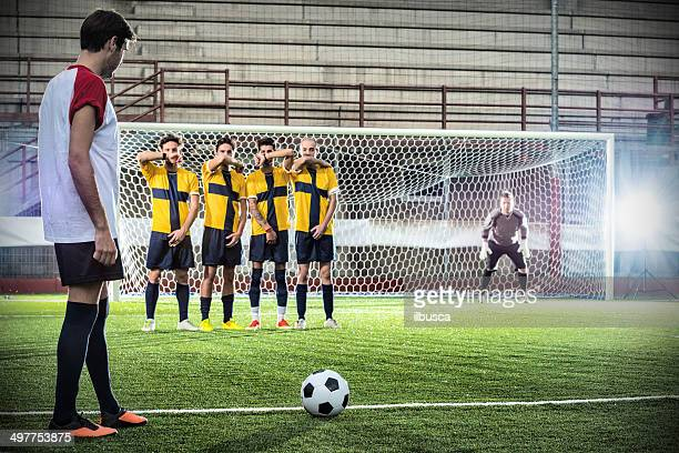 Football match in stadium: Free kick