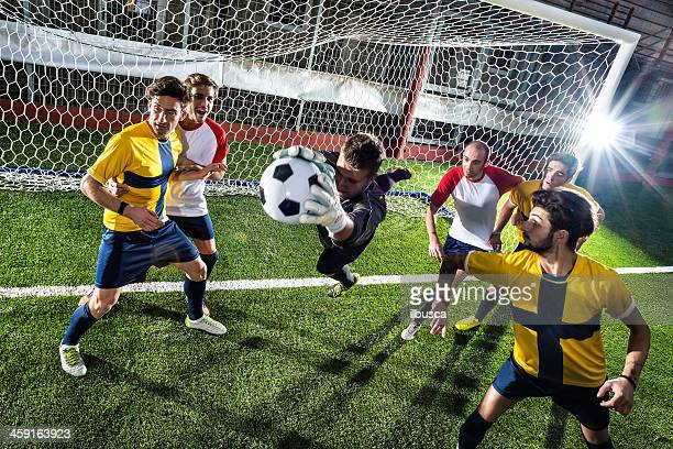 football match in stadium: goalkeeper save - soccer competition stock pictures, royalty-free photos & images