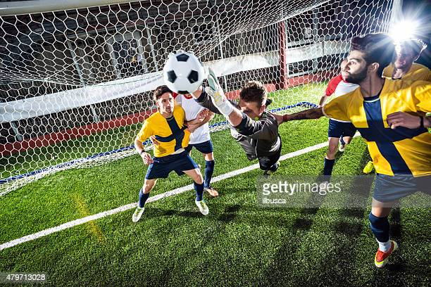 Football match in stadium: Goalkeeper save