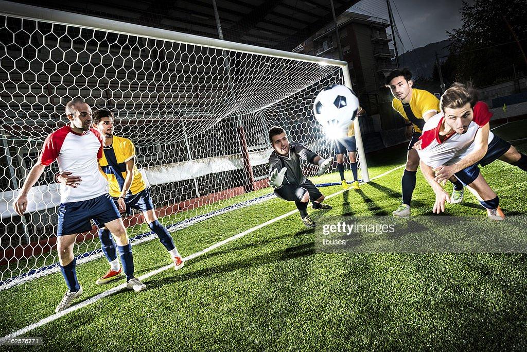 Football match in stadium: Header goal : Stock Photo