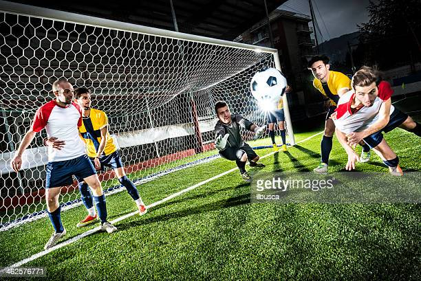 Football match in stadium: Header goal