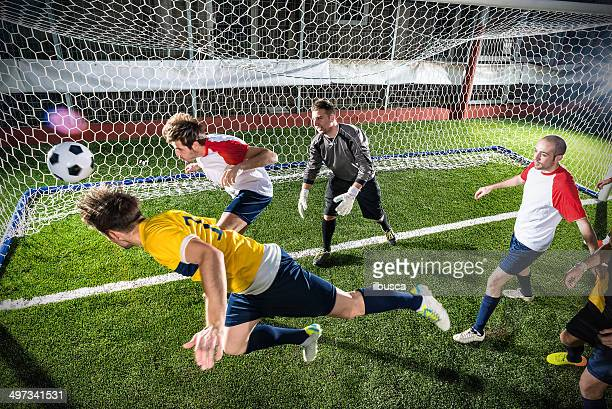 football match in stadium: header goal - heading the ball stock pictures, royalty-free photos & images