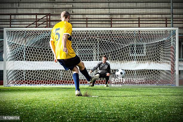football match in stadium: penalty kick - penalty stock pictures, royalty-free photos & images