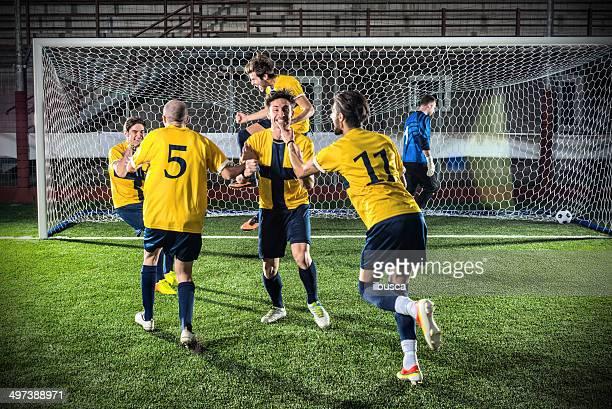 Football match in stadium: Scorer's celebration