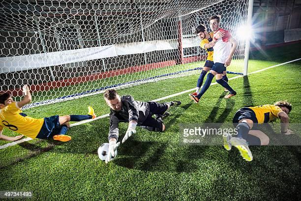 Football match in stadium: Striker's goal