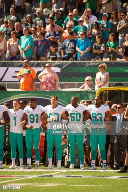 Miami Dolphins Cody Parkey Cameron Wake Charles Harris Andre Branch and Ndamukong Suh link arms in solidarity during the National Anthem before game...