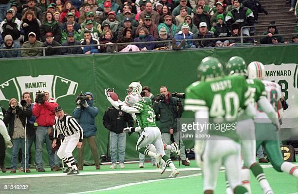 Football Miami Dolphins Mark Ingram in action making catch and scoring game winning touchdown from QB Dan Marino's game winning fake spike pass vs...