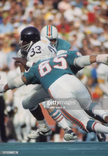 Miami Dolphins Nick Buoniconti in action tackling vs Pittsburgh Steelers John Fuqua at Orange Bowl Stadium Miami FL CREDIT Walter Iooss Jr