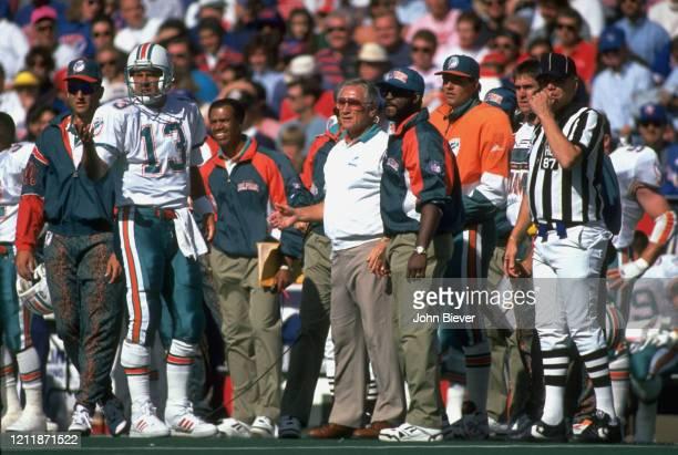 Miami Dolphins QB Dan Marino on sidelines with coach Don Shula and assistants during game vs Buffalo Bills at Rich Stadium Orchard Park NY CREDIT...