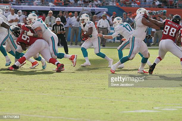 Miami Dolphins Richie Incognito in action, block for for running back Daniel Thomas vs Atlanta Falcons Corey Peters at Sun Life Stadium. Miami...