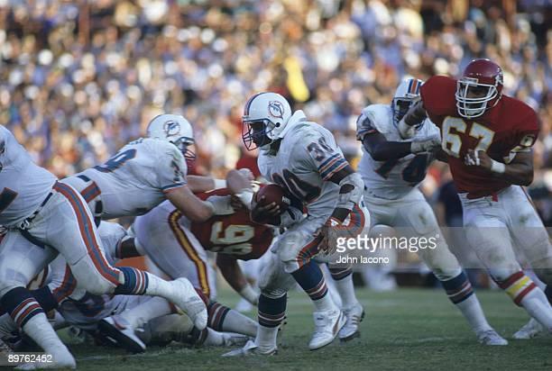 Miami Dolphins Ron Davenport in action vs Kansas City Chiefs Art Still Miami FL 9/22/1985 CREDIT John Iacono